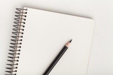 Top view of open spiral blank notebook with pencil on white desk  background: Royalty-free images, photos and pictures