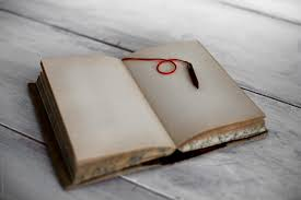 Open Journal on a table. by Darren Muir - Stocksy United