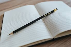 Royalty-Free photo: Person writing in ruled paper   PickPik