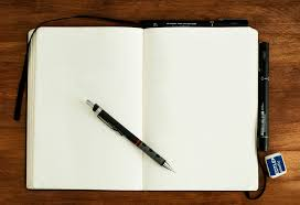 black and silver retractable pen on blank book photo – Free Book Image on  Unsplash