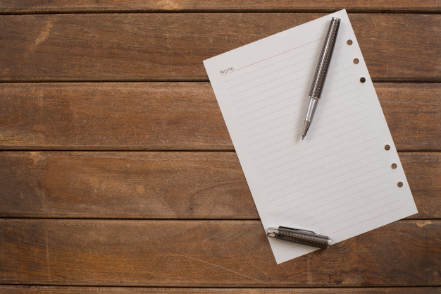 Download this Free Photo | Notepad with pen on office wooden table.
